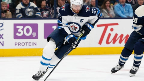 <p>               FILE - In this Jan. 22, 2020, file photo, Winnipeg Jets' Blake Wheeler plays against the Columbus Blue Jackets during an NHL hockey game in Columbus, Ohio. Wheeler and the Winnipeg Jets would have been on the road last week, trying to make a final push for the playoffs had the National Hockey League season not been called off because of the pandemic. Now the seven-time All-Star forward is home for dinner each night with his family. (AP Photo/Jay LaPrete, File)             </p>