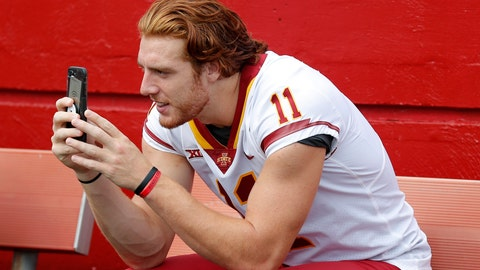 <p>               FILE - In this Aug. 7, 2018, file photo, Iowa State tight end Chase Allen takes a photo with his cell phone during Iowa State's annual NCAA college football media day in Ames, Iowa. While autograph-signing and public appearances have been traditional ways athletes could make extra money, opportunities now are tied to social media posts where athletes could in the future be paid for posting sponsored content. (AP Photo/Charlie Neibergall, File)             </p>