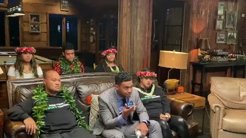 <p>               In this still image from video provided by the NFL, Tua Tagovailoa, front center, holds up a phone during the NFL football draft Thursday, April 23, 2020. The Miami Dolphins selected Tagovailoa with the fifth pick. (NFL via AP)             </p>