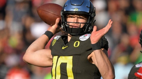 <p>               FILE - In this Jan. 1, 2020, file photo, Oregon quarterback Justin Herbert passes against Wisconsin during first half of the Rose Bowl NCAA college football game in Pasadena, Calif. Herbert is a likely first-round pick in the NFL draft Thursday, April 23, 2020. (AP Photo/Mark J. Terrill, File)             </p>