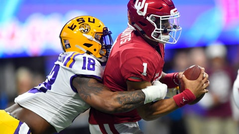 <p>               FILE - In this Dec. 28, 2019, file photo, LSU linebacker K'Lavon Chaisson (18) sacks Oklahoma quarterback Jalen Hurts (1) during the first half of the Peach Bowl NCAA semifinal college football playoff game in Atlanta. Chaisson was chosen by the Jacksonville Jaguars in the first round of the NFL draft Thursday, April 23, 2020.  (AP Photo/John Amis, File)             </p>
