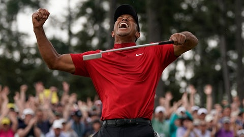 <p>               FILE - In this April 14, 2019, file photo, Tiger Woods reacts as he wins the Masters golf tournament at Augusta National in Augusta, Ga. It was voted the third best Masters. Woods blazing to victory in his Sunday red at the Masters, a scene once so familiar, was never more stunning.  (AP Photo/David J. Phillip, File)             </p>