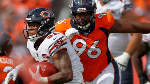 <p>               FILE - In this Sept. 15, 2019, file photo, Chicago Bears running back David Montgomery (32) is pursued by Denver Broncos defensive tackle Shelby Harris (96) during the first half of an NFL football game in Denver. The coronavirus pandemic has forced NFL teams to make free agent decisions without the benefit of meeting players face to face. That suppressed the market for plenty of lower-tier free agents such as Harris who signed a one-year deal for $2.5 million with a chance to earn another $750,000. (AP Photo/David Zalubowski, File)             </p>