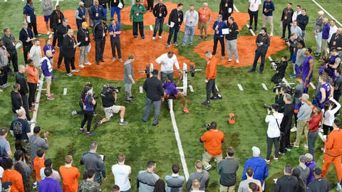 <p>               FILE - In this March 12, 2020, file photo, Clemson football player Tee Higgins lifts weights during NFL Pro Day in Clemson, S.C. Scouts, front-office executives and even coaches find themselves coping with a whole new process with Americans hunkering down and doctors overwhelmed by the mounting cases of COVID-19. Gone for the most part this year are access to in-person interviews, campus workouts and visits to team headquarters. (AP Photo/Richard Shiro, File)             </p>