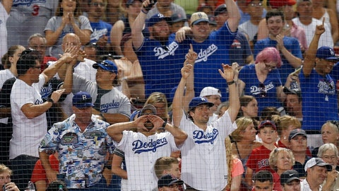 <p>               FILE - In this July 13, 2019, file photo, Los Angeles Dodgers fans celebrate a solo home run by Cody Bellinger during the seventh inning of a baseball game against the Boston Red Sox in Boston. Whenever the baseball season begins, Los Angeles Dodgers fans who subscribe to DirecTV and its subsidiaries will have access to the team's regional sports network after a deal ended a nearly seven-year stalemate. (AP Photo/Michael Dwyer, File)             </p>