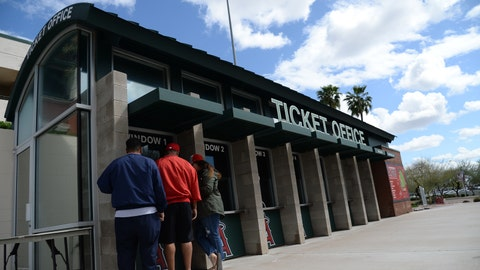 Mar 13, 2020; Tempe, Arizona, USA; Fans seek a refund at the box office of Tempe Diablo Stadium following the cancellation of spring training games due to concerns over the Covid 19 coronavirus. Mandatory Credit: Joe Camporeale-USA TODAY Sports