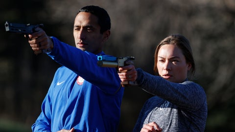 <p>               USA Olympic modern pentathlon team members Amro ElGeziry and his wife, Isabella Isaksen practice shooting at targets in a park in Colorado Springs, Colo., Friday, April 24, 2020. Amro Elgeziry and Isabella Isaksen are just your ordinary married Olympic modern pentathlon couple trying to navigate their way through the challenges of training during the coronavirus pandemic. Their sport consists of five events, but they can't practice equestrian horse jumping or swimming at the moment with the facilities closed. For the rest, they improvise. They practice their fencing footwork in the backyard, shoot laser pistols at a target in a nearby park and squeeze in early morning runs along trails as they train for the Tokyo Games in 2021. (AP Photo/David Zalubowski)             </p>