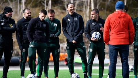 <p>               Zlatan Ibrahimovic, center right, takes part in a training session with the Swedish team Hammarby in Stockholm, Sweden, Monday April 13, 2020. Due to the Coronavirus emergency in Italy, Ibrahimovic is currently in Stockholm to spend time with his family, and is training with Hammarby, a club he has invested in. (Henrik Montgomery/TT News Agency via AP)             </p>