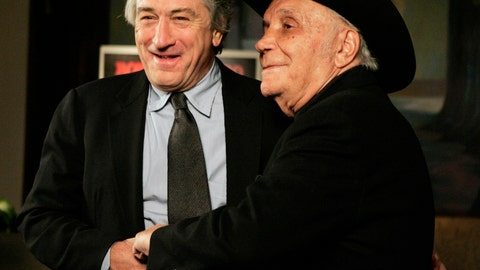"""<p>               FILE - In this Jan. 27, 2005, file photo, Robert De Niro, left, and boxer Jake LaMotta stand for photographers before watching a 25th anniversary screening of the movie """"Raging Bull,"""" in New York. """"Raging Bull,"""" about the life of Jake Lamotta, was No. 7 in The Associated Press' Top 25 favorite sports movies poll. (AP Photo/Julie Jacobson, File)             </p>"""