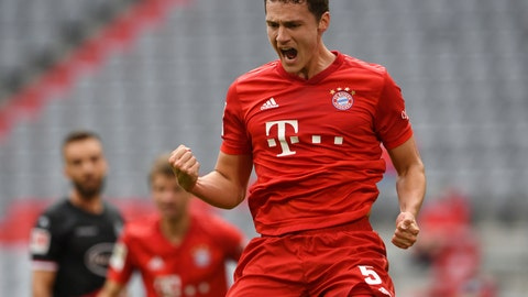 <p>               Munich's Benjamin Pavard celebrates his 2-0 after scoring during the German Bundesliga soccer match between FC Bayern Munich and Fortuna Duesseldorf in Munich, Germany, Saturday, May 30, 2020. Because of the coronavirus outbreak all soccer matches of the German Bundesliga take place without spectators. (Christof Stache/Pool via AP)             </p>