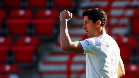 <p>               Robert Lewandowski of Munich celebrates his side's opening goal during the German Bundesliga soccer match between Union Berlin and Bayern Munich in Berlin, Germany, Sunday, May 17, 2020. The German Bundesliga becomes the world's first major soccer league to resume after a two-month suspension because of the coronavirus pandemic. (AP Photo/Hannibal Hanschke, Pool)             </p>