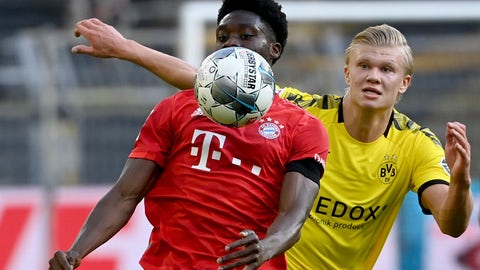 <p>               Munich's Alphonso Davies, left, and Dortmund's Erling Haaland, right, challenge for the ball during the German Bundesliga soccer match between Borussia Dortmund and FC Bayern Munich in Dortmund, Germany, Tuesday, May 26, 2020. The German Bundesliga is the world's first major soccer league to resume after a two-month suspension because of the coronavirus pandemic. (Federico Gambarini/DPA via AP, Pool)             </p>