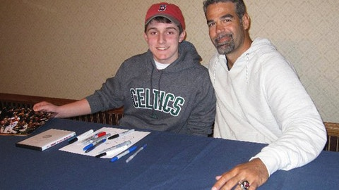 <p>               In this 2011 photo provided by David Cotillo, his son Chris Cotillo, left, poses with former Boston Red Sox third baseman Mike Lowell during an autograph session in Boston. Chris Cotillo, a Red Sox beat writer for MassLive.com in 2020, raised tens of thousands of dollars by selling autographed baseball memorabilia he had collected as a teen and that others donated for the auction. (David Cotillo via AP)             </p>