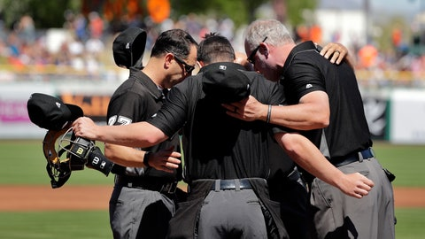 <p>               In this March 23, 2019 file photo umpires Jim Reynolds, left, Sean Ryan, Ted Barrett (hidden) and Kerwin Danley, right, huddle before a spring training baseball game between the San Francisco Giants and Arizona Diamondbacks in Scottsdale, Ariz. Major League Baseball and its umpires have reached a deal to cover a 2020 pay structure during the coronavirus pandemic, including a 50% cut in May and nothing more this year if no games are played. The sides struck an agreement late Thursday, April 30, 2020 two people told The Associated Press. (AP Photo/Elaine Thompson, file)             </p>
