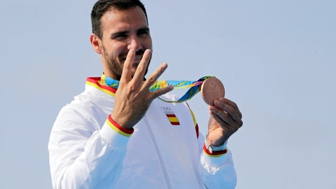 <p>               FILE - In this Saturday, Aug. 20, 2016, file photo, Spain's Saul Craviotto celebrates his bronze medal in the men's kayak single 200m final during the 2016 Summer Olympics in Rio de Janeiro, Brazil. It wasn't long ago that Saul Craviotto was sitting in his kayak contemplating a much-anticipated announcement from the Spanish Olympic Committee but now he is among some of the Spanish athletes and sportspeople who have rejoined the police force to help the hard-hit southern European country during the pandemic. He was set to be named the country's flag-bearer for the opening ceremonies in Tokyo. (AP Photo/Matt York, file)             </p>