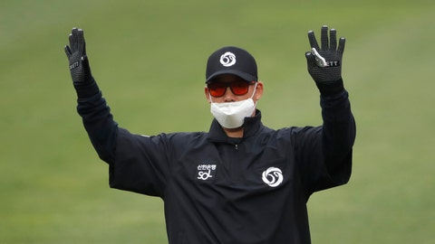 <p>               Second base umpire Kim Jun-hee wearing a mask and gloves as a precaution against the new coronavirus calls during a baseball game between Hanwha Eagles and SK Wyverns in Incheon, South Korea, Tuesday, May 5, 2020. With umpires fitted with masks and cheerleaders dancing beneath vast rows of empty seats, a new baseball season got underway in South Korea following a weeks-long delay because of the coronavirus pandemic.(AP Photo/Lee Jin-man)             </p>
