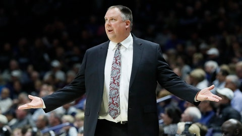 """<p>               FILE - In this Dec. 4, 2019, file photo, Green Bay head coach Linc Darner gestures during the first half of an NCAA college basketball game against Xavier in Cincinnati. Darner is out as the men's basketball coach at Green Bay after posting winning records in four of his five seasons on the job. Chancellor Michael Alexander confirmed the move Monday, May 18, 2020, saying in a statement that the university and coach """"have decided to part ways.""""(AP Photo/John Minchillo, File)             </p>"""