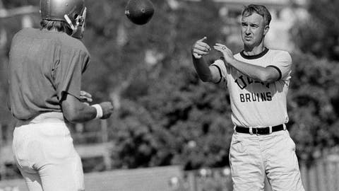 <p>               FILE - In this Sept. 13, 1972, file photo, UCLA quarterback Mark Harmon, left, son of former Michigan Heisman Trophy winner Tom Harmon, works out with coach Pepper Rodgers, right, in Los Angeles. Rodgers, a colorful personality who helped Georgia Tech to an unbeaten season as a player in 1952 and went on to coach the Yellow Jackets as well as Kansas, UCLA and in the United States Football League, died Thursday, May 14, 2020, at the age of 88. His alma mater announced his death. A statement from Georgia Tech said Rodgers died in Reston, Va. No cause was given.  (AP Photo/GB, File)             </p>