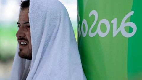 <p>               FILE - In this Aug. 17, 2016, file photo, Britain's Mark Dry rests with a towel on his head during the men's hammer throw qualification during the athletics competitions of the 2016 Summer Olympics at the Olympic stadium in Rio de Janeiro, Brazil. Dry told anti-doping authorities he had gone fishing when he was really at his parents' house. A little white lie has turned into what could be a career-ending fiasco. The 2016 Olympian is serving a four-year ban for tampering with the anti-doping process. (AP Photo/Matt Slocum, File)             </p>