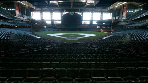 <p>               FILE - In this Tuesday, April 28, 2020, file photo, a darkened Chase Field, home of the Arizona Diamondbacks of baseball's National League, sits empty. Major League Baseball owners gave the go-ahead Monday, May 11, 2020, to making a proposal to the players' union that could lead to the coronavirus-delayed season starting around the Fourth of July weekend in ballparks without fans, a plan that envisions expanding the designated hitter to the National League for 2020. (AP Photo/Ross D. Franklin, File)             </p>