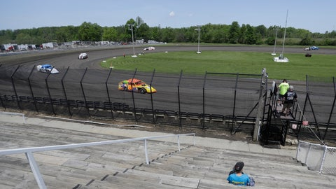 <p>               A fan watches as cars practice on a short dirt track at Gas City I-69 Speedway, Sunday, May 24, 2020, in Gas City, Ind. (AP Photo/Darron Cummings)             </p>