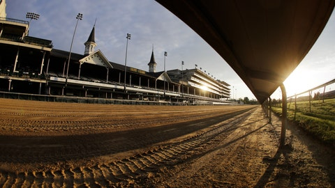 <p>               FILE - In this May 7, 2020 file photo the sun rises over the track at Churchill Downs in Louisville, Ky. Horse racing is in a state of transition at a time usually reserved for Triple Crown season. The Preakness would have been run Saturday, May 16, 2020 in Baltimore. But Pimlico Race Course and many tracks across North America remain dark because of the coronavirus pandemic. There is some light at the end of the tunnel as tracks including Churchill Downs in Kentucky are getting back to live racing without fans. (AP Photo/Darron Cummings, file)             </p>