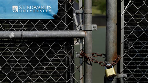 <p>               The gates of St. Edwards' Brother Emmett Strohmeyer Tennis Courts are locked and marked closed due to the coronavirus outbreak, Tuesday, May 5, 2020, in Austin, Texas. In response to the economic impact of COVID-19, St. Edwards says they are cutting cut six sports programs including men's and women's tennis, men's and women's golf and men's soccer. (AP Photo/Eric Gay)             </p>