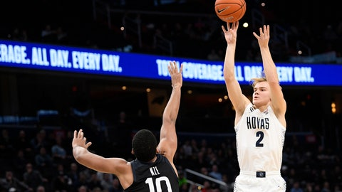 <p>               FILE - In this Tuesday, Jan. 28, 2020, file photo, Georgetown guard Mac McClung (2) shoots as he is defended by Butler forward Bryce Nze (10) during the second half of an NCAA college basketball game, in Washington. McClung announced Wednesday, May 13, 2020, that he plans to enter the NCAA transfer portal so he can switch schools after taking his name out of consideration for the NBA draft. (AP Photo/Nick Wass, File)             </p>