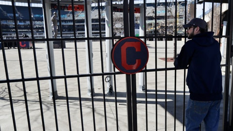 <p>               FILE - In this March 26, 2020, file photo, Jason Hackedorn looks into Progressive Field, home of the Cleveland Indians baseball team, in Cleveland. With the distinct possibility of pro sports resuming in empty venues, a recent poll suggests a majority of U.S. fans wouldn't feel safe attending games anyway without a coronavirus vaccine.(AP Photo/Tony Dejak, File)             </p>
