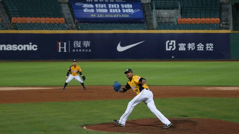 <p>               This Friday, April 24, 2020, photo, shows Chinatrust Brothers players during a game against  Fubon Guardians with no audience at Xinzhuang Baseball Stadium in New Taipei City, Taiwan. Taiwan's five-team Chinese Professional Baseball League is barring spectators over concerns of spreading the coronavirus in a crowded space. But Taiwan has relatively few cases of COVID-19, so the league decided it was safe to let in players, coaches, cheerleaders, costumed mascots, face mask-wearing batboys and the media. (AP Photo/Chiang Ying-ying)             </p>