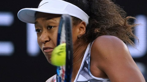 <p>               Japan's Naomi Osaka makes a backhand return to Coco Gauff of the U.S. during their third round singles match at the Australian Open tennis championship in Melbourne, Australia, Friday, Jan. 24, 2020. (AP Photo/Lee Jin-man)             </p>