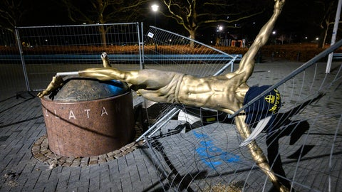 <p>               FILE - In this Sunday Jan. 5, 2020 file photo, the damaged statue of soccer player Zlatan Ibrahimovic next to Stadion football arena in Malmo, Sweden. The much-vandalized statue of Zlatan Ibrahimovic is staying in Malmo. Committee members from the Swedish city's council have held a meeting Monday, May 18 to discuss proposals from local citizens about where to move the statue of the soccer player from its current location outside Malmo's stadium. The bronze sculpture has been repeatedly attacked since Ibrahimovic become a part-owner in Hammarby.(Johan Nilsson/TT via AP, file)             </p>