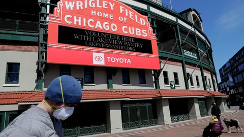 <p>               FILE - In this April 16, 2020 file photo, Wrigley Field's marquee displays Lakeview Pantry volunteer information in Chicago. The Chicago Cubs are instituting pay cuts because of the coronavirus crisis, but there will be no furloughs through the end of June. A person with direct knowledge of the situation says the pay cuts were based on compensation. President of baseball operations Theo Epstein and president of business operations Crane Kenney took the highest reductions. The person, who spoke to The Associated Press on Thursday, May 21, 2020 on condition of anonymity because of the sensitivity of the situation, says 80% of associates are taking a pay cut of 20% or less.  (AP Photo/Nam Y. Huh, File)             </p>