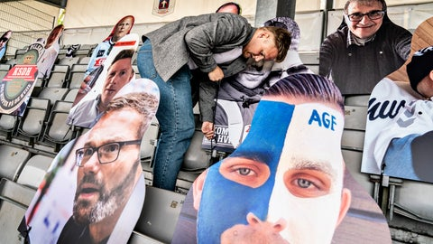 "<p>               Pictures of soccer fans are placed in the stands as Ceres Park Football Stadium gets ready for the Danish Superliga match between AGF and Randers FC in Aarhus, Denmark, Wednesday May 27, 2020. FC Midtjylland and AGF Aarhus have gotten creative as they look to generate some atmosphere because games have to be played in empty stadiums. Midtjylland is planning a ""drive-in"" where about 2,000 supporters can watch games from inside their cars in a parking lot outside the team's stadium. Aarhus is installing three giant screens along one side of the field displaying the faces of about 10,000 fans on a live video call. The first match of the Danish Superliga will be played Thursday evening May 28 in Aarhus. (Henning Bagger/Ritzau scanpix via AP)             </p>"