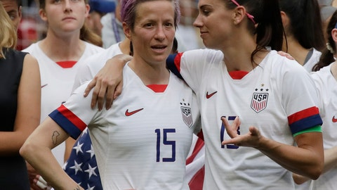<p>               FILE - In this July 7, 2019, file photo, United States' Megan Rapinoe, left, talks to her teammate Alex Morgan, right, after winning the Women's World Cup final soccer match against Netherlands at the Stade de Lyon in Decines, outside Lyon, France. Players for the U.S. women's national team may have been dealt a blow by a judge's ruling in their gender discrimination case against U.S. Soccer, but the case is far from over. On Friday a federal judge threw out the players' unequal pay in a surprising loss for the defending World Cup champions. But the judge allowed aspects of their allegations of discriminatory working conditions to go to trial. (AP Photo/Alessandra Tarantino, File)             </p>