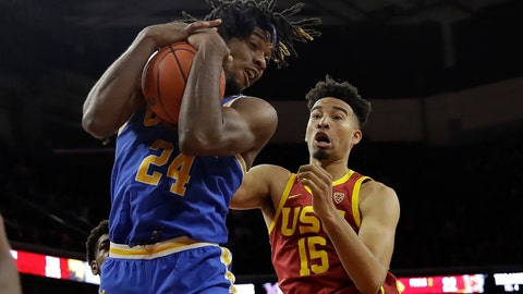 <p>               UCLA forward Jalen Hill (24) grabs a rebound next to Southern California forward Isaiah Mobley (15) during the first half of an NCAA college basketball game Saturday, March 7, 2020, in Los Angeles. (AP Photo/Marcio Jose Sanchez)             </p>
