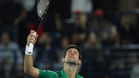 <p>               Serbia's Novak Djokovic celebrates after he beats Stefanos Tsitsipas of Greece in the final match of the Dubai Duty Free Tennis Championship in Dubai, United Arab Emirates, Saturday, Feb. 29, 2020. (AP Photo/Kamran Jebreili)             </p>