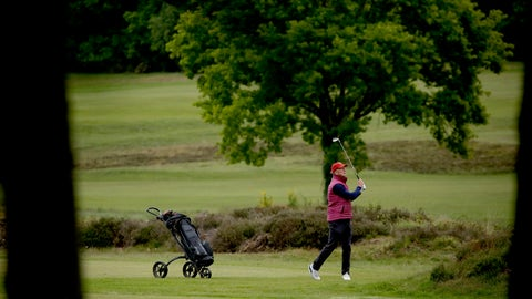 <p>               A golfer hits a shot after Sunningdale Golf Club reopened this morning as part of the British government relaxing the coronavirus lockdown measures, in Sunningdale, England, Wednesday, May 13, 2020. Tennis courts and golf courses in England can reopen from Wednesday, the sports venues were ordered to be closed in March when Britain imposed a national lockdown due to the coronavirus outbreak. (AP Photo/Matt Dunham)             </p>