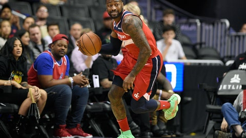 "<p>               FILE - In this Dec. 1, 2018, file photo, Washington Wizards guard John Wall (2) dribbles the ball during the first half of an NBA basketball game against the Brooklyn Nets in Washington. Wizards point guard John Wall says he is ""110%"" healthy after missing the past 1½ years with two major injuries. He is working out at home and looking forward to getting back to the NBA next season.(AP Photo/Nick Wass, File)             </p>"