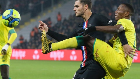 <p>               Nantes' Charles Traore, center right, gets to the ball before PSG's Mauro Icardi during the League One soccer match between Nantes and Paris-Saint-Germain, in Nantes, western France, Tuesday, Feb. 4, 2020. (AP Photo/David Vincent)             </p>