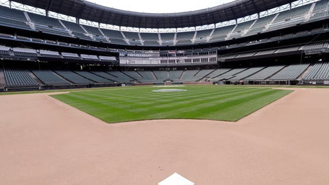 <p>               Second base sits in its place in an otherwise empty ballpark where grounds crew members continue to keep the Seattle Mariners' field in playing shape as the ballpark goes into its seventh week without baseball played because of the coronavirus outbreak Monday, May 11, 2020, in Seattle. A person familiar with the decision tells The Associated Press that Major League Baseball owners have given the go-ahead to making a proposal to the players' union that could lead to the coronavirus-delayed season starting around the Fourth of July weekend in ballparks without fans. (AP Photo/Elaine Thompson)             </p>