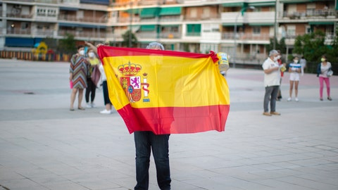 <p>               A woman holds a Spanish flag during a protest against the Spanish government amid the lockdown to prevent the spread of coronavirus in Alcorcon, Spain, Friday, May 22, 2020. The Spanish government is allowing Madrid and Barcelona to ease their lockdown measures, which were introduced to fight the coronavirus pandemic. (AP Photo/Manu Fernandez)             </p>