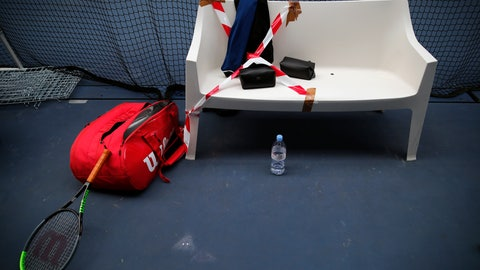 <p>               The tennis bench of french veteran Nicolas Mahut is sticked with white and red ribbon during a training session in the French Tennis Federation center near the grounds of the French Open in Paris, Wednesday, May 13, 2020 under the watchful eye of a team doctor and courtside trainers. Professional tennis players resumed training in France after the end of lockdown amid the coronavirus pandemic. (AP Photo/Francois Mori)             </p>