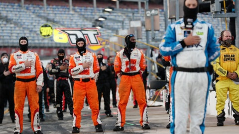 <p>               Crew members stand during the national anthem before a NASCAR Truck Series auto race at Charlotte Motor Speedway Tuesday, May 26, 2020 in Concord, N.C. (AP Photo/Gerry Broome)             </p>