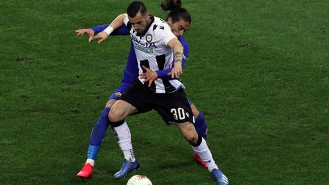 <p>               FILE - In this March 8, 2020 file photo, Fiorentina's Martin Caceres and Udinese's Ilija Nestrovski, foreground, vie for the ball during the Italian Serie A soccer match between Udinese and Fiorentina, at the Dacia Arena stadium in Udine, Italy.  Udinese president Giampaolo Pozzo recalled that the team was quarantined, after learning that Fiorentina -- the team it faced on March 8 a day before the league was suspended -- had three players who tested positive for COVID-19. (Andrea Bressanutti/LaPresse via AP)             </p>