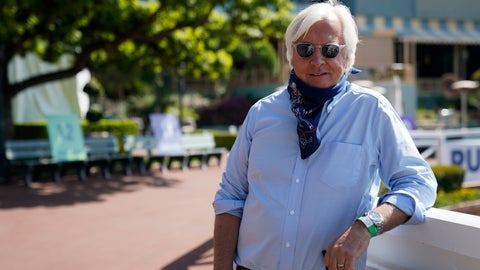 <p>               In this Friday, May 22, 2020 photo, Bob Baffert, two-time Triple Crown-winning trainer, lowers his bandana during an interview while keeping his distance at Santa Anita Park in Arcadia, Calif. Horse racing returned to the track after being idled for one and a half months because of public health officials' concerns about the coronavirus pandemic. (AP Photo/Ashley Landis)             </p>