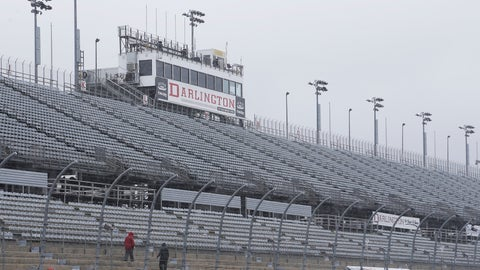<p>               FILE - In this Sept. 2, 2016, file photo, workers walk along the grandstands in the rain at Darlington Raceway after weather forced NASCAR to call off qualifying for the Sprint Cup and XFinity series auto races. NASCAR says it will resume its season without fans present starting May 17 at Darlington Raceway in South Carolina. (AP Photo/Terry Renna, File)             </p>