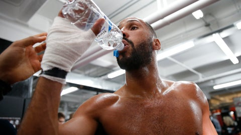 """<p>               FILE - In this Wednesday, Jan. 11, 2017 file photo, International Boxing Federation super middleweight champion James DeGale of England takes some water during a workout with his coach in the ring at Gleason's gym in the Brooklyn borough of New York, in New York. The head of the British Boxing Board of Control said Wednesday May 6, 2020, the body was working on an """"apparatus"""" that would allow fighters to safely spit out water as they catch their breath between rounds. It's among dozens of protective measures under discussion under a plan to protect fighters from the coronavirus when boxing resumes in Britain, possibly in July. (AP Photo/Kathy Willens, File)             </p>"""