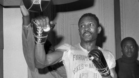 """<p>               FILE - In this April 1969 file photo, welterweight boxer Curtis Cokes trains for his fight against Joe Napoles in Los Angeles. Cokes, the Hall of Fame welterweight who became Dallas' first world champion in 1966, has died. He was 82. Erwin """"Sparky"""" Sparks, Cokes' partner at the Home of Champions gym, told The Dallas Morning News that Cokes died Friday, May 29, 2020, after a week in hospice. (AP Photo, File)             </p>"""