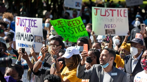<p>               People react during a rally to protest the shooting of Ahmaud Arbery, an unarmed black man Friday, May 8, 2020, in Brunswick Ga. Two men have been charged with murder in the February shooting death of Arbery, whom they had pursued in a truck after spotting him running in their neighborhood. (AP Photo/John Bazemore)             </p>